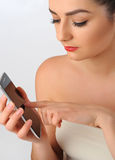 Portrait of beautiful woman with cell phone. Stock Image