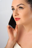 Portrait of beautiful woman with cell phone. Royalty Free Stock Image