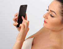 Portrait of beautiful woman with cell phone. Stock Images