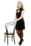 Portrait of a beautiful woman with a chair Stock Photography