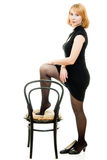 Portrait of a beautiful woman with a chair Stock Photos