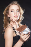 Portrait of beautiful woman with a chocolate Royalty Free Stock Photography