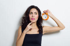 Portrait of beautiful woman with clock in hands Stock Photography
