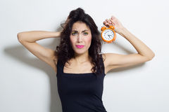 Portrait of beautiful woman with clock in hands Royalty Free Stock Image