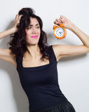 Portrait of beautiful woman with clock in hands Royalty Free Stock Photos