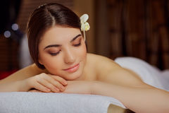 Portrait of a beautiful woman close-up lying down in a spa salon stock photos