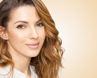 Portrait of beautiful woman, close up studio on yellow background Royalty Free Stock Images