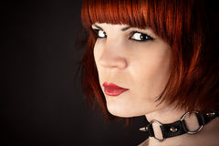 Portrait of a beautiful woman with a collar. On the neck Stock Image