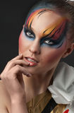 Portrait of beautiful woman with colorful make-Up. Fashion portrait of young beautiful woman with bright decorative make-up. (Professional makeup and hair style Stock Photo