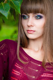 Portrait of beautiful woman with colorful make up. Portrait of beautiful woman with creative make up and long straight hair outdoors Royalty Free Stock Photos