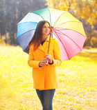 Portrait beautiful woman with colorful umbrella in warm sunny autumn. Day Stock Photos
