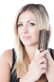 Portrait of beautiful  woman combing her blondy hair Royalty Free Stock Images