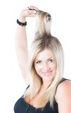 Portrait of beautiful  woman combing her blondy hair Stock Images