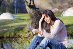 Portrait of beautiful woman counting money in the park Stock Images