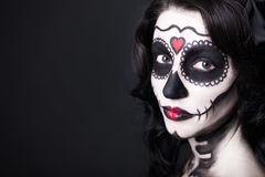 Portrait of beautiful woman with creative sugar skull make up ov Stock Image