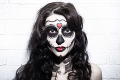 Portrait of beautiful woman with creative sugar skull make up ov Royalty Free Stock Images