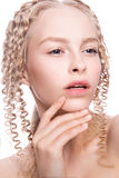 Portrait of a beautiful woman with curly blonde stock image