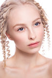 Portrait of a beautiful woman with curly blonde royalty free stock images
