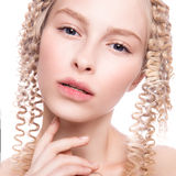 Portrait of a beautiful woman with curly blonde stock images