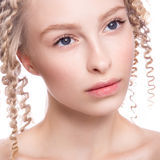 Portrait of a beautiful woman with curly blonde stock photo