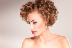 Portrait of beautiful woman with curly hair Royalty Free Stock Photography
