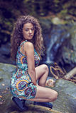 Portrait of a beautiful woman with curly hair Royalty Free Stock Photography