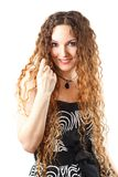 Portrait of beautiful  woman with curly long hair on white background. Stock Images