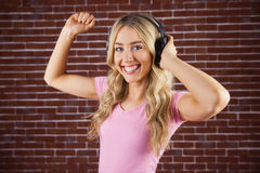 Portrait of a beautiful woman dancing with headphones Stock Images