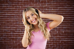 Portrait of a beautiful woman dancing with headphones Stock Photos