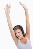 Portrait of a beautiful woman dancing while listening to music Stock Photo