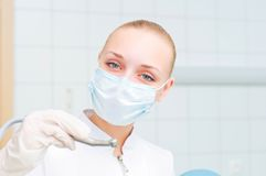 Portrait of a beautiful woman dentist, Stock Images