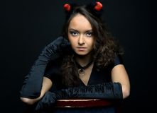 Portrait of the beautiful woman in devil costume Royalty Free Stock Photography
