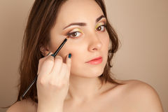 Portrait of beautiful woman doing her make-up. Portrait of beautiful gorgeous woman doing her make-up Stock Photos