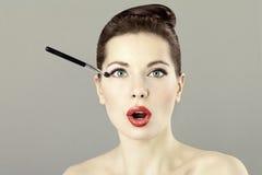 Portrait of beautiful woman doing makeup Stock Photo