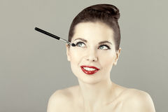 Portrait of beautiful woman doing makeup Royalty Free Stock Image