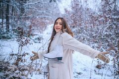 Portrait of a beautiful woman dressed a coat. Young woman winter portrait. Sensual brunette winter girl posing and royalty free stock images
