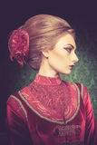 Portrait of beautiful woman dressed vintage clothes in retro int Stock Photography