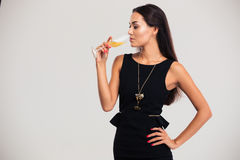 Portrait of a beautiful woman drinking champagne Stock Image