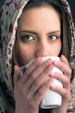 Portrait of a beautiful woman drinking coffee Royalty Free Stock Image