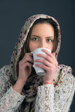 Portrait of a beautiful woman drinking coffee Stock Image