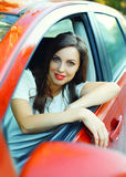 Portrait beautiful woman driver behind wheel red car Stock Photo