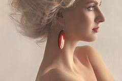 Portrait of a beautiful woman with an earring on a Royalty Free Stock Photo