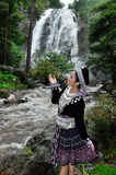 Portrait of beautiful woman enjoy with waterfall Royalty Free Stock Image
