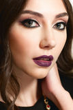 Portrait of beautiful woman with evening makeup Stock Photography