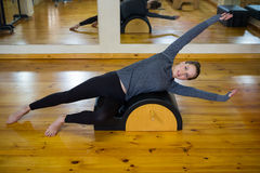 Portrait of beautiful woman exercising on arc barrel Royalty Free Stock Photos