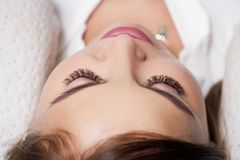 Portrait of a beautiful woman with extra lashes. Close up of woman`s face with extra lashes on her eyes Stock Photo