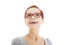Portrait of beautiful woman in eyeglasses looking up. Royalty Free Stock Photos
