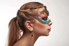 Portrait of beautiful woman with facial body art hiding half of Royalty Free Stock Images