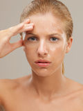 Portrait beautiful woman with facial mask frowning Stock Image