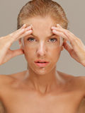 Portrait beautiful woman with facial mask frowning Royalty Free Stock Images
